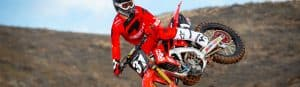picture of rider on a dirt bike for motorcycle oil aricle