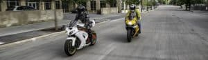 picture of two riders on metric bikes for motorcycle oil article